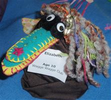 Bird puppet on tin at Horizons 2010